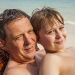 Father is spooning with his happy smiling son — Stock Photo #19428645