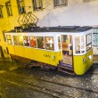 Traditional yellow tram downtown Lisbon by night — Stock Photo #19438787