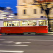 Постер, плакат: Historic tram operates in vienna in late afternoon in first dist