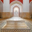 Inside humayuns tomb with marble tomb - Stock Photo