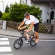 Father and son ride on bike — Stock Photo
