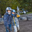 Child loves to race with a quad at the muddy quad track - Stock Photo