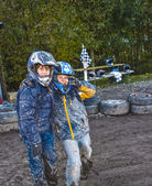 Child loves to race with a quad at the muddy quad track — Stock Photo