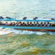 Travel in the typical long boat at the river Mae Nam Chao — Stock Photo #19589171
