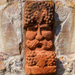 Old medieval stone wall with face of baccus, the god of winery — Stock Photo