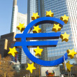 Euro symbol in front of the European Central Bank with occupy ca — Stock Photo #19658265