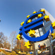 Stock Photo: Euro symbol in front of EuropeCentral Bank with occupy ca