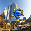 Euro symbol in front of the European Central Bank with occupy ca — Stock Photo #19658809