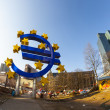 Euro symbol in front of the European Central Bank with occupy ca — Stock Photo #19658951
