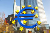 Euro symbol in front of the European Central Bank with occupy ca — Stock Photo