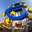 Euro symbol in front of the European Central Bank with occupy ca — Stock Photo #19671129