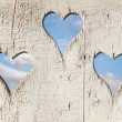 Heart shape look out on wooden door to outhouse. — Stock Photo