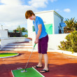 Boy playing mini golf in the course — Stock Photo #19705121