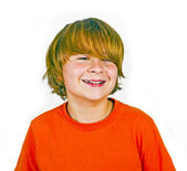Handsome smiling boy in orange shirt — Stock Photo