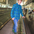 Young boy on a moving staircase inside the airport — Stock Photo #19834545
