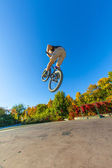 Boy going airborne with his dirt bike — Stock Photo