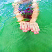 Detail of hands swimming in the ocean — Stock Photo