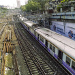 Old rusty rails leading to Mumbai Central Station with spare rai — Stock Photo