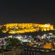 Historical Mehrangarh Fort in Jodhpur at night, Rajasthan, India - Stock Photo