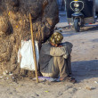 Indian street beggar seeking alms on the street - Lizenzfreies Foto