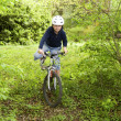 Stock Photo: Young boy with mountain bike on tour