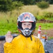 Stock Photo: Happy boy with helmet at kart trail