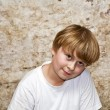 Stock Photo: Boy with light brown hair and brown eyes lookes friendly
