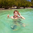 Young boy enjoys swimming in the clear warm sea and has fun — Stock Photo