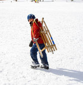 Young boy sledding down the hill in snow, white winter — Stock Photo