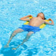 Boy swimming in the pool - Stok fotoğraf