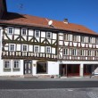 Apostel half timbered house in fairy tale town of Steinau — Stock Photo #20506311