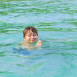 Boy enjoys swimming in the ocean — Stock Photo #20589009