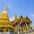 Stock Photo: Famous temple PhrSri RatanChedi covered with foil gold
