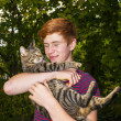 Cute boy with red hair with his cat in the arm — Stock Photo