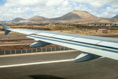 Takeoff at airport of Lanzarote with volcanoes at the horizon — Stock Photo