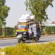 Public transport in India .Crazy road scene -truck with overload — Stock Photo