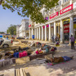 Stock Photo: Construction workers relax at Connaught Place