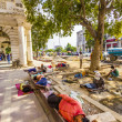 Construction workers relax at the Connaught Place - Stock Photo