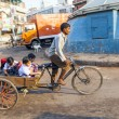Father transports his children in cycle rickshaw — Stock Photo #21761309