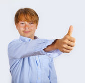 Cute young happy boy in studio shows i like it sign with his thu — Stock Photo