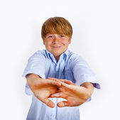 Cute young happy boy shows his hands — Stock Photo