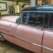 Pink 1956 Cadillac at the airport - Stock Photo