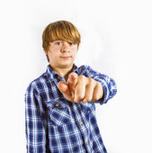 Portrait of cute young happy boy pointing to someone — Stock Photo