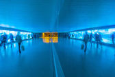 Tunnel with pedestrians in motion in blue cool light — Foto Stock