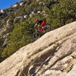 Downhill bike rider rides down the mount Lemmon — Stock Photo