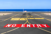 No entry sign at the runway of the airport with ocean in backgro — Stock Photo