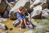 Tourists check the photos of lower Yosemite Waterfall — Stock Photo