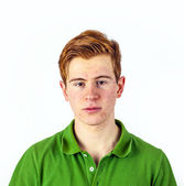 Cool boy in green shirt with red hair — Stock Photo