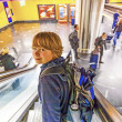 Boy on a moving staircase  in the station — Stock Photo