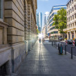 Attractive womon sidewalk downtown Frankfurt — Stock Photo #26687281